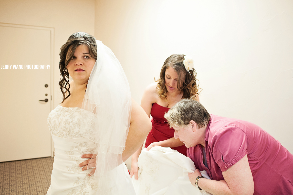 Putting the final touches on the bride's dress